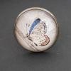 Fjäril med orange och blå detaljer, justerbar ring i bronsfärg