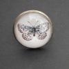 Fjäril med ljusblå ton, justerbar ring i bronsfärg